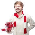 Young smiling man holding christmas gifts portrait of cheerful caucasian which with happy smile Stock Photography