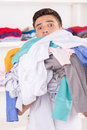 Young smiling man holding laundry portrait of carrying dirty clothes Royalty Free Stock Photo