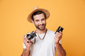 Young smiling man looking camera while holding lens Royalty Free Stock Photo