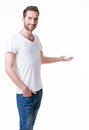 Young smiling man shows something on arm isolated white Royalty Free Stock Images