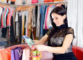 Young smiling pretty brunette shopping in mall Royalty Free Stock Photos