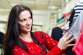 Young smiling pretty brunette shopping in mall Royalty Free Stock Image