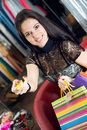 Young smiling pretty brunette shopping in mall Royalty Free Stock Photo