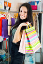 Young smiling pretty brunette shopping in mall Stock Image