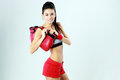Young smiling sport woman standing with boxing gloves on gray background Royalty Free Stock Photography