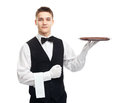 Young smiling waiter with empty tray portrait of happy isolated on white background Stock Image