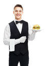 Young smiling waiter holding hamburger on plate Royalty Free Stock Photo