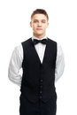Young smiling waiter isolated on white background portrait of standing with hands behind his back Royalty Free Stock Image