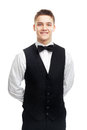 Young smiling waiter isolated on white background portrait of standing with hands behind his back Royalty Free Stock Photo