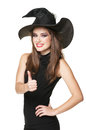 The  young smiling witch in a black dress Stock Photos