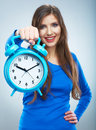 Young smiling woman in blue hold watch. Beautiful smiling girl Royalty Free Stock Photo