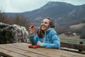 Young smiling woman eating strawberries in the nature on a backg Royalty Free Stock Photo