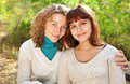 Young smiling woman with her teen daughter Royalty Free Stock Photos