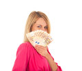 Young smiling woman holding fan made of Euro money Royalty Free Stock Photo
