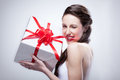 Young smiling woman holding gift on white background Royalty Free Stock Image
