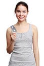 Young smiling woman holding meds in the hands isolated on white background Royalty Free Stock Image