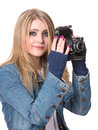 Young smiling woman holding a vintage photo camera Royalty Free Stock Images