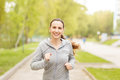 Young smiling woman jogging in park in the morning Royalty Free Stock Photo