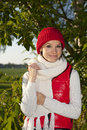 Young smiling woman keep herself warm in nature suuroundings Royalty Free Stock Image