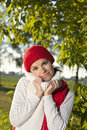 Young smiling woman keep herself warm in nature suuroundings Royalty Free Stock Photos