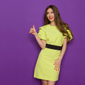 Young Smiling Woman In Lime Green Dress Gives Thumb Up Royalty Free Stock Photo