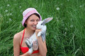 Young smiling woman and rabbit Stock Images