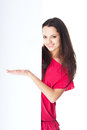 Young smiling woman showing blank signboard pretty in red dress isolated on white background Royalty Free Stock Image