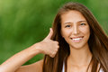 Young smiling woman showing gesture Royalty Free Stock Photos
