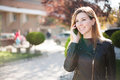 Young smiling woman talking on mobile phone. Royalty Free Stock Photo