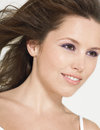 Young smiling woman with wind swept hair closeup of a beautiful Royalty Free Stock Image