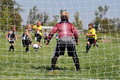 Young Soccer Goalie thru Netting Royalty Free Stock Photos