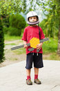 Young soldier boy is guarding holding a plastic gun Royalty Free Stock Photo