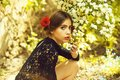 Young spanish girl with red lips and rose in hair Royalty Free Stock Photo