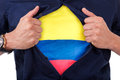 Young sport fan opening his shirt and showing the flag his count country colombia colombian Royalty Free Stock Photos