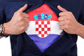 Young sport fan opening his shirt and showing the flag his count country croatia croatian Stock Photo
