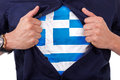 Young sport fan opening his shirt and showing the flag his count country greece greek Royalty Free Stock Image