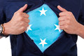 Young sport fan opening his shirt and showing the flag his count country micronesia micronesian Stock Images