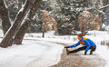 Young sport woman doing exercises during winter training outside in cold snow weather Royalty Free Stock Photo