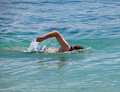 Young sporting man swims in  sea Royalty Free Stock Photo