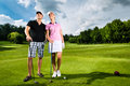 Young sportive couple playing golf on a course Stock Images