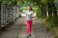 Young sports girl during a jog in the Park. Running Royalty Free Stock Photo