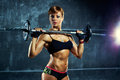 Young sports woman with barbell Royalty Free Stock Images