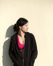 Young sports woman standing outside with black sweatshirt portrait of a Stock Image