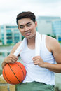 Young sportsman vertical portrait of a with a ball looking at camera Royalty Free Stock Photos