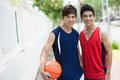 Young sportsmen portrait of two boys with a ball looking at camera Royalty Free Stock Photography