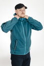 Young sporty man adjust collar his jacket collar Stock Photo