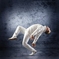 Young and sporty modern dancer over the dramatic background Stock Images