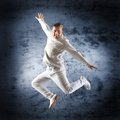 Young and sporty modern dancer over the dramatic background Stock Photos