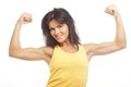 Young sporty woman flexing her biceps isolated on white Royalty Free Stock Image