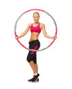 Young sporty woman with hula hoop picture of Royalty Free Stock Image